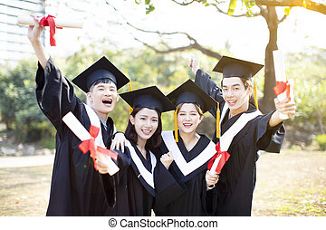 group of happy students celebrating graduation