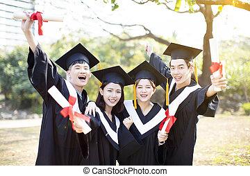 group of happy students celebrating graduation