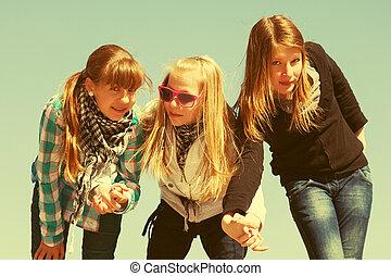Group of happy teen girls