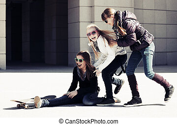 Group of happy teen girls with skateboard