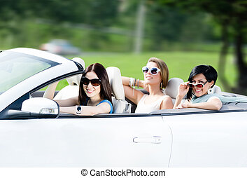 Group of happy teenagers in the cabriolet