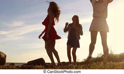 group of happy women or girls dancing on beach 56