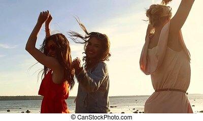 group of happy women or girls dancing on beach 35