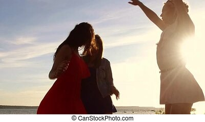 group of happy women or girls dancing on beach 49
