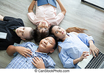 Group Of Happy Young Friends on the floor