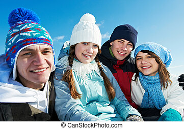 group of happy young people in winter - happy young smiling ...