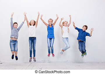 Group of happy young people jumping on white background