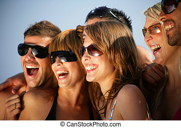 Group of happy young people on holiday