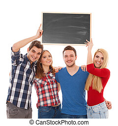 Group of happy young people with a blackboard