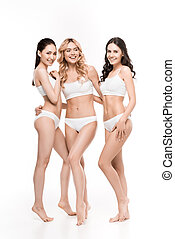 group of happy young women in lingerie posing isolated on white