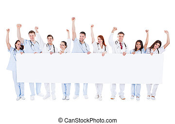 Group of healthcare personnel holding a banner - Large...