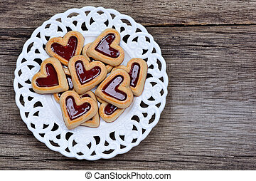 Group of heart cookies in a plate on table
