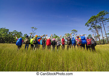 Group Of Hiker standing in field