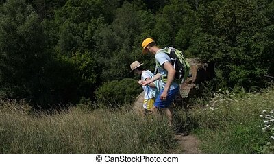Group of hikers stepping down along rocky path - Group of...
