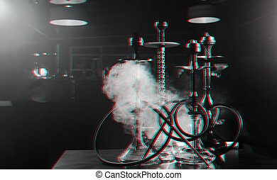 group of hookahs on the table in a restaurant