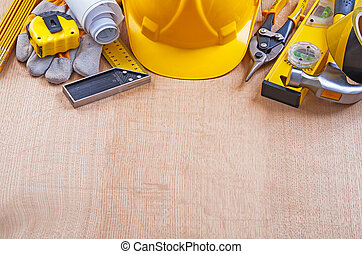Group of house  improvement tools on oak wooden board constructi