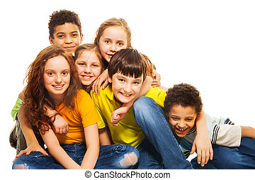 Group of hugging and laughing kids
