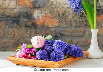 Group of hyacinth flowers in a wooden frame. Life style photo. Copy space.