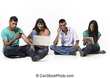 Group of Indian friends using modern technology.