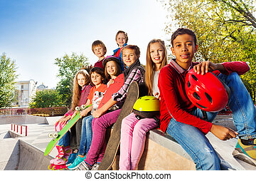 Group of international children with skateboards