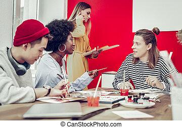 Group of international people that visiting art school