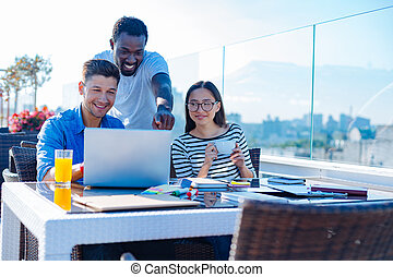 Group of international student studying outdoors