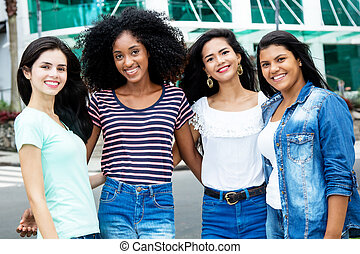 Group of international young adult women in city