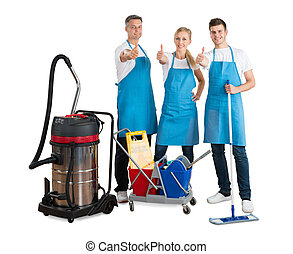 Group Of Janitors With Their Cleaning Equipment
