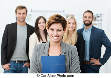 Group of job applicants with a smiling confident young woman...
