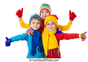 Group of kids in winter clothes and ok sign