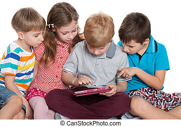 Group of kids plaing with a gadget