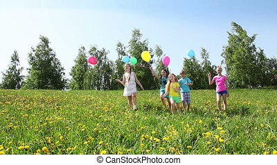 Group of kids run with balloons
