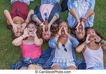 group of kids shouting or singing