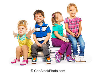 Group of kids sitting on the books stack