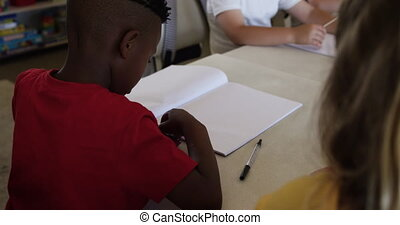 Group of kids studying in the class - Multi-ethnic group of ...