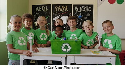 Group of kids wearing recycle symbol t shirt in the class - ...
