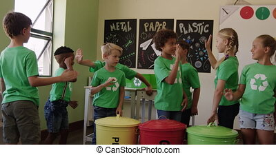 Group of kids wearing recycle symbol tshirt giving high ...