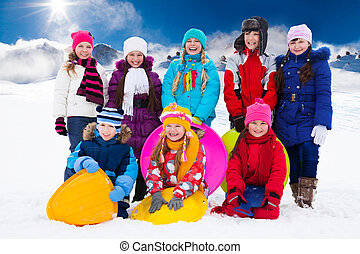 Group of kids with sleds