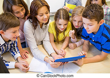 group of kids with teacher and tablet pc at school -...