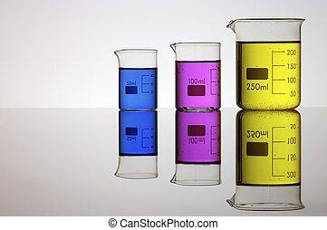 laboratory - group of laboratory beakers containing liquid...