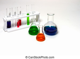 Group of laboratory flasks empty or filled with a clear liquid.