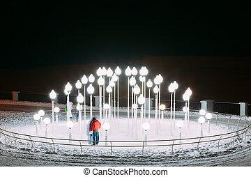 Lanters in Snowy winter city park. Night. Gomel, Belarus