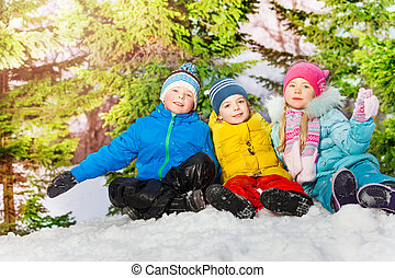 Group of little kids in the snow park at winter
