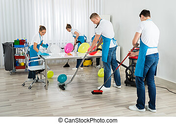 Janitors Cleaning The Office After Party