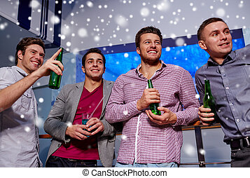 group of male friends with beer in nightclub - winter,...