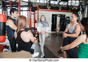 Group of man and woman fitness streching