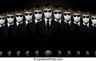 man in black costume in medical mask - group of man in black...