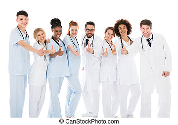 Group Of Medical Team Gesturing Thumbs Up