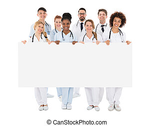 Group Of Medical Team Holding Blank Billboard