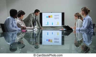 group of men and women at meeting - Business people talking...